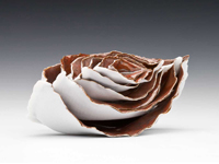 "Nested Boats porcelain, persimmon glaze  3"" x 2"" x 5 5"""